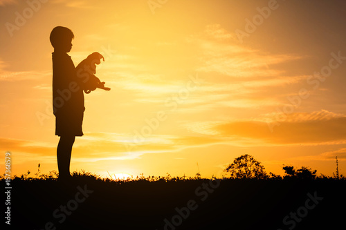 Fototapety, obrazy: Silhouette child playing with dogs, Concept play with dog.