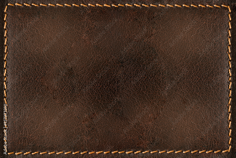Fototapeta Brown leather background with seams