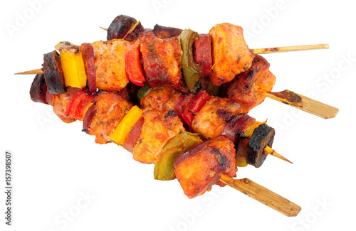 Chicken and spicy chorizo sausage kebabs with sweet peppers isolated on a white background