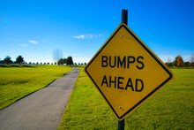 Bumps Ahead Sign Near Paved Pa...