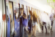 Blurred People Getting In Rail...