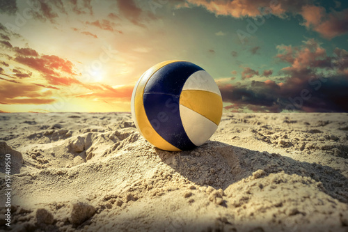 Beach Volleyball. Game ball under sunlight and blue sky.