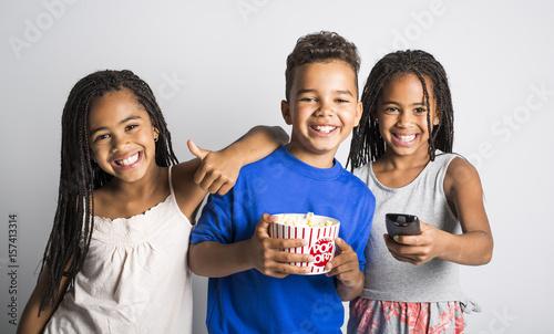 black little boy and sister girl watching movie with pop corn Fototapeta