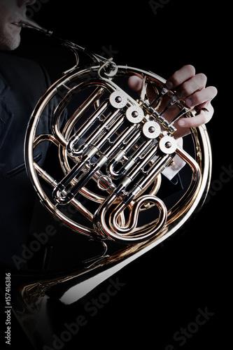 Spoed Fotobehang Muziek French horn instrument. Player hands playing horn music