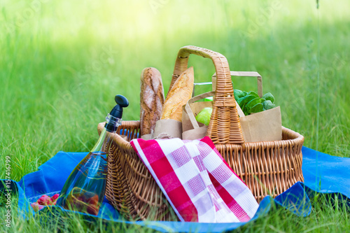 Staande foto Picknick Summer basket for picnic with wine, bread, fruits and snacks