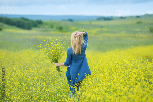 Genuine cute lady woman in meadow of yellow flowers sniffing flower genuine cute lady woman in meadow of yellow flowers sniffing flower bouquet attractive beautiful young mightylinksfo