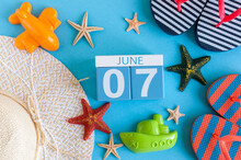 June 7th. Image Of June 7 Calendar On Blue Background With Summer Beach, Traveler Outfit And Accessories. Summer Day