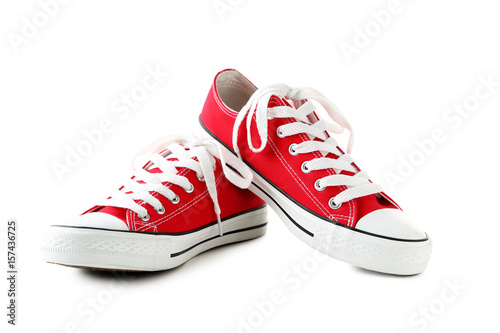 Pair of red sneakers isolated on a white Fototapeta