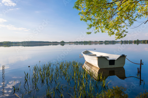 Foto op Aluminium Meer / Vijver Rowing boat floating over the Lake Selment Wielki waters. Masuria, Poland.