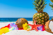 Coconuts and pineapples on a tropical beach