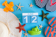 June 12th. Image Of June 12 Calendar On Blue Background With Summer Beach, Traveler Outfit And Accessories. Summer Day