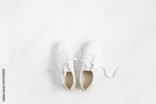 Fotografia  White female sneakers isolated on white background