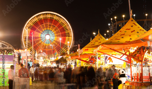 Photo  State Fair Carnival Midway Games Rides Ferris Wheel
