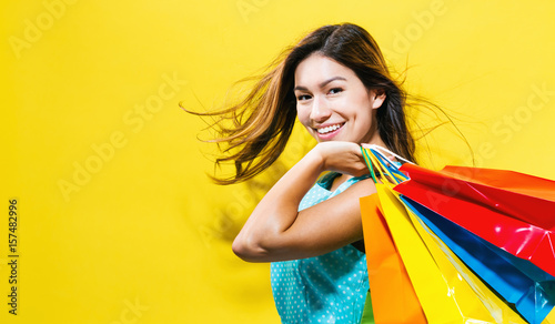 Fotografie, Obraz  Happy young woman holding shopping bags
