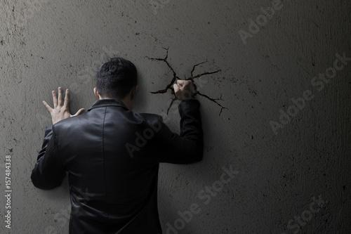 Vászonkép Sad buisness man feeling bad, hopeless, depressed, frustrated and repressed, Man hit the wall
