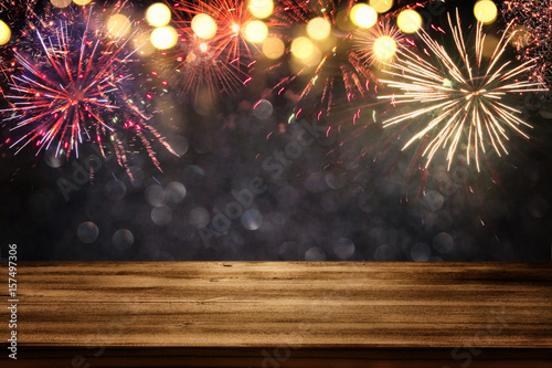Photo  Empty wooden table in front of fireworks background