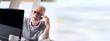 Portrait of bearded senior businessman talking on mobile phone
