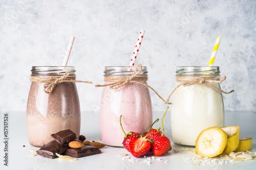 Staande foto Milkshake Banana chocolate and strawberry milkshakes