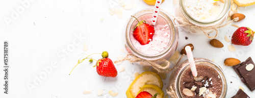 Photo sur Toile Lait, Milk-shake Banana chocolate and strawberry milkshakes. Long banner format