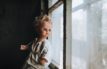 The Old Doll Looks Out The Win...
