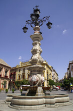 Sevilla (Spain). Fuente-lamppost In The Virgen De Los Reyes Square In The City Of Seville