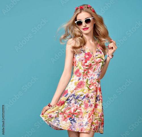Fashion Beauty. Sensual Sexy Blond Model in fashion pose Smiling. Woman in Summer Outfit. Trendy Floral Dress, Stylish wavy hairstyle, fashion Flower Pink Hairband. Playful Happy Romantic summer Girl Wall mural