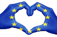 European Union Flag Painted On Hands Forming A Heart Isolated On White Background, Europe Love Help Concept