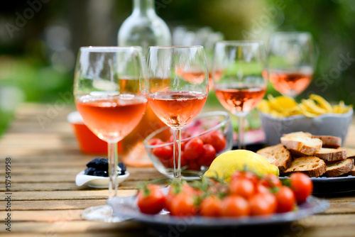 Poster de jardin Buffet, Bar holiday summer brunch party table outdoor in a house backyard with appetizer, glass of rosé wine, fresh drink and organic vegetables