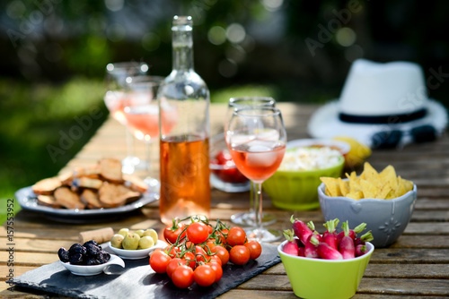 In de dag Buffet, Bar holiday summer brunch party table outdoor in a house backyard with appetizer, glass of rosé wine, fresh drink and organic vegetables