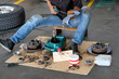 Mechanic lubricate a roller bearing with lithium grease