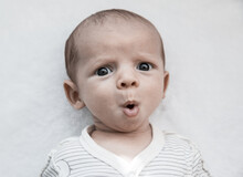 Portrait Of Cute Surprised Baby Boy
