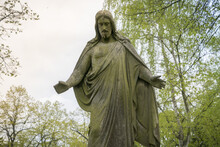 Old Sculpture Of Jesus In A Park