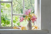 Lilies Bouquet On A Window Sil...