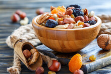 Wooden Bowl With Nuts And Drie...