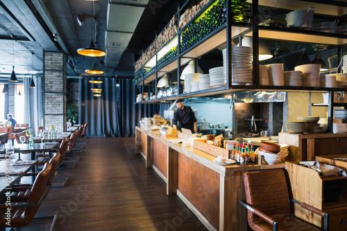 Fotobehang Restaurant modern loft style restaurant decoration with hanging light bulb beer pub and bar.