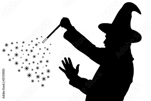 Silhouette of bearded wizard in cloak with pointed hat creating magic фототапет