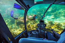 Underwater Submarine Ship Following A Woman In Apnea Swimming In Tropical Turquoise Sea Of Racha Noi, Phuket In Thailand. Cockpit Interior View. Undersea Background. Travel Concept.