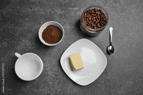 Foto op Plexiglas Coffee and butter on gray background