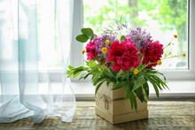 Gift Box With Beautiful Floral Composition Of Different Flowers On Wooden Window Sill