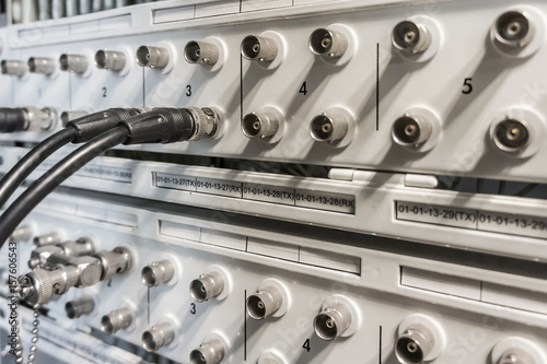 Coaxial cable plugged into BNC interface port of communication equipment Wallpaper Mural