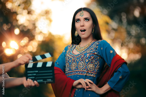 Photo  Surprised Bollywood Actress Wearing an Indian Outfit and Jewelry