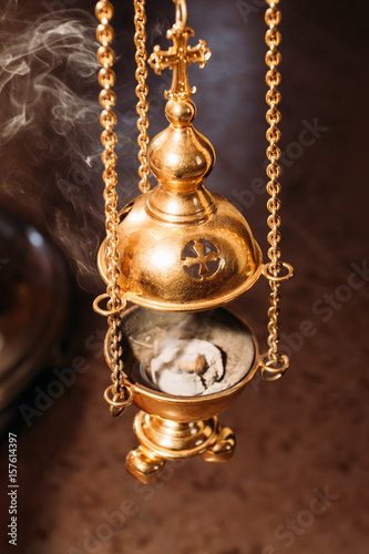 The church censer emits smoke Fototapeta
