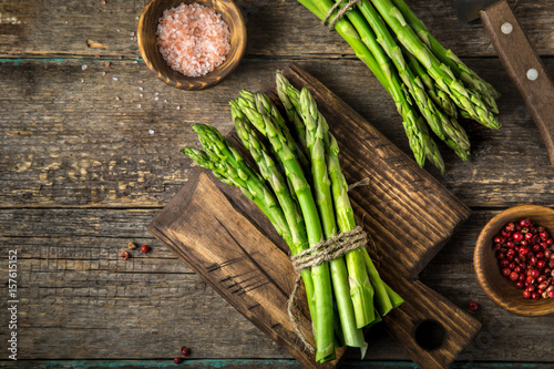 banches of fresh green asparagus on wooden background Canvas Print
