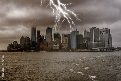 Foto op Aluminium New York Manhattan from the water with stormy sky