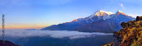 Photo Stands Lavender Mountain Landscape in Himalaya. Above clouds. Annapurna South peak.