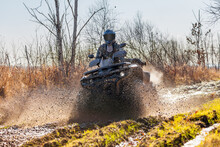ATV Racer Drives Through Mud And Water