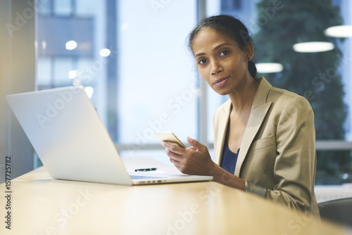 Fotografie, Obraz  Portrait of attractive afro american female administrative watching streaming vi