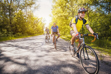 Bikers On A Summer Workout On A Forest Road