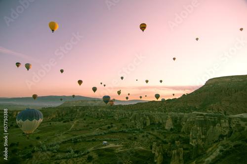 Wall Murals Light pink Beautiful balloons in sunrise light in Cappadocia