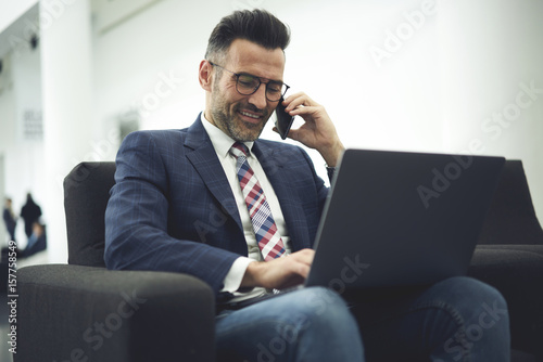 Formally Dressed Experienced Male Entrepreneur Making Distance Work